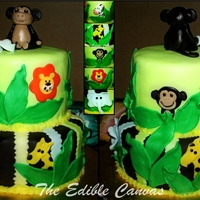 "Jungle Themed Baby Shower Cake 8"" and 6"" Vanilla and Strawberry cake. Buttercream and Colored & Chocolate Fondant. Hand made fondant animals & blue baby..."