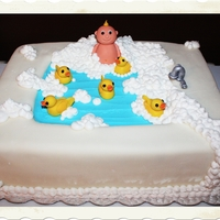 Baby Boy Bathtub Duckie Shower Cake 11 x 15, 2 layer chocolate fudge cake with Bavarian Creme filling, buttercream icing and homemade fondant. Baby, Duckies and Faucet are...