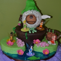 Pixie Hollow Fairy Birthday! This cake was for my daughter who turned 5. Tinkerbell's house is made from white chocolate with fondant accents. Flowers made of...