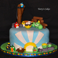 Angry Birds!! This cake was made for a good friend that is young at heart. Chocolate cake with handmade cake topper!