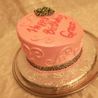 Tosy Turvy Birthday Buttercream with pearl dust. Zebra print is ribbon
