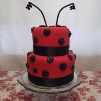 Ladybug Red Duff Fondant with black buttercream dots and black satin ribbon.
