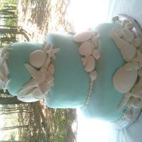 Beach Wedding Cake - 5/19 This cake was created for a beach wedding held at Cape Henlopen State Park on 5/19/12. Beautiful wedding and a gorgeous day. Enjoy!