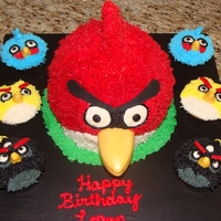 Angry Bird Cake And Cupcakes Red angry bird cake using ball pan all hand piped buttercream. Beak is fondant/gumpaste. Cupcakes are hand piped buttercream as well
