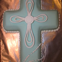 First Holy Communion This cake was for my son's First Holy Communion. Blue MMF w/white fondant decorations & rosary (strung on fishing line). Piped...