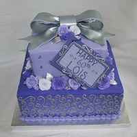 "Lois' Purple Passion buttercream icing with fondant and gumpaste accents. bow is gumpaste painted with edible silver airbrush ""paint"""
