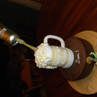 Beer Stein And Beer Barrel The beer stein is made of 4 - 4 inch cakes with two sets of dowel supports. One is for the top two cakes and the other is at the bottom of...