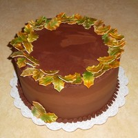 "Fall Leaves  8"" covered in chocolate ganache and decorated with airbrushed gumpaste leaves. The cake was perfectly smooth, but the ganache set up..."