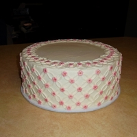 Piped Circles With Flowers  This was inspired by one of Melody Brandon's creations (Sweet and Saucy Shop). Cake was for a coworker's shower potluck. Butter...