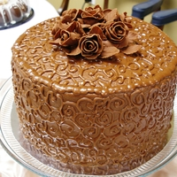 Chocolate Mocha Cake 4 layers...with Mocha filling & Chocolate Butter Cream Icing w/ Chocolate Fondant Roses