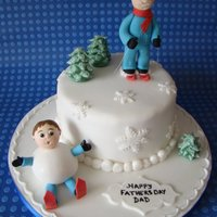 "Skiing! a 6"" round cake - all figures and trees are made from gumpaste by hand. Tree's have a coating of royal icing brushed on."