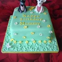 "A Dog Cake Made for a lady who loved her dogs. A 7"" square cake - covered with fondant - dogs made from gumpaste."