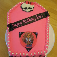 Monster High Birthday Cake I Took A 12 Sheet Cake Cut In Half And Stacked It Then Carved Into Coffin Shape Skull If Fondant And Printe Monster High birthday cake. I took a 1/2 sheet cake cut in half and stacked it, then carved into coffin shape. Skull if fondant and printed...