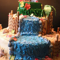 Luau Wedding Cake  This is a three tiered wedding cake for a luau-themed wedding. All elements of this cake are edible with the exception of the adirondack...