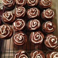 Chocolate And Marshmallow   chocolate cupcake with chocolate buttercream frosting, filled with a marshmallow creme and marshmallow creme swirled on top!