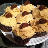Peanut Butter Cups Cupcakes   chocolate cupcake, peanut butter frosting, and half a mini cup on top!