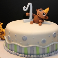 Animal Theme First Birthday Cake This cake was red velvet with cream cheese and whipped icing, and was for a little boy's first birthday!