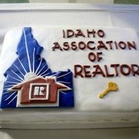 Idaho Association Of Realtors Cake Chocolate Cake with White Chocolate Ganache and Chocolate Buttercream. They wanted the exact replica of their logo but 3D, we later found...