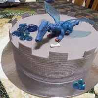 Dragon Cake  Dragon cake for my nephew. Dragon is gumpaste with gelatin wings and isomalt stash of gems, chomping down on a bone sticking out of his...