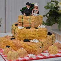 "A Country Wedding  Lemon, chocolate and vanilla layers. Buttercream icing with fondant accents. Everything is handmade except the tractor. Too bad the ""..."