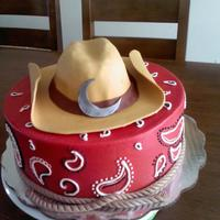 Cowboy Cake vanilla cake with caramel filling, Buttercream and fondant accents