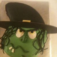 Witch witch covered with buttercream. Hat is poster board.