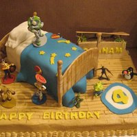 Toy Story bed is cake,covered in fondant, frame, toybox are made of gumpaste, sheet cake is covered in buttercream and floor hand painted. figures...