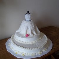 Yes To The Dress Made this for my daughter wedding shower, bottom tier was lemon with lemon curd filling, middle layer is whte with rasberry filling, the...