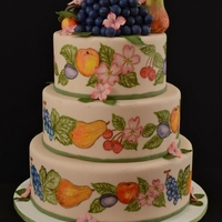 Market Day Wedding Cake  This was a cake for the decorated cakes competition at our state fair. The cake was covered in fondant and the fruit details were hand-...