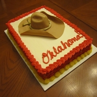 "Oklahoma! Cake   This was a cake I made for an ""Oklahoma"" cast party. The hat was make of a gumpaste-fondant mix."