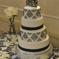 Black And White Wedding Cake   Wedding cake with custom topper with stenciled pattern in royal icing.