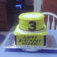 Ayden's Bumblebee Transformer Cake This is a yellow cake on the bottom tier, chocolate fudge cake on the top tier , The whole cake is covered in homemade buttercream. TFL...