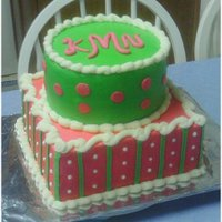 Pink & Green Monogram Cake This is a yellow cake with all homemade buttercream. The initials are MMF . Edible Pearls for the dots on the bottom. TFL