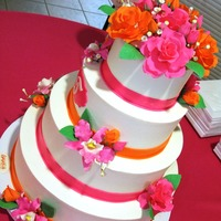 Pink And Orange Floral  Pink and orange have been very popular this season! The cake tiers includes cookies 'n cream with ganache, chocolate with ganache and...