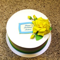 Yellow Rose Birthday Cake This is a lemon cake, topped with lemon syrup and filled with cream cheese and lemon curd fillings, iced in vanilla buttercream with a...