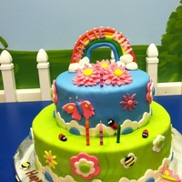 Rainbow Flower Garden Birthday Cake   This cake was designed using elements from 2 cakes. All embellishments are fondant.