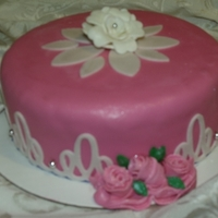 My Sisters Birthday Cake German chocolate cake covered with buttercream then in fondant. Pink and white roses were hand made. White side swirls and top under white...