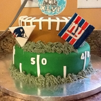 Superbowl 2012 Yellow 2 tier cake. Covered in fondant. Gum-paste accents. TFL