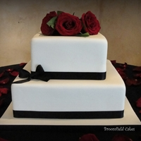 Simple Fondant Wedding Cake. I was nervous about this cake from the second I accepted it... glad it went smoothly. I wish the bride had a better topper for it. TFL.