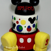 Mickey Cake All fondant. Top is a half styrofoam ball covered in fondant. Feet are RKT covered in THREE layers of fondant... am I missing something...