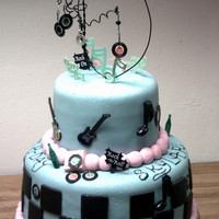 Retro Rock In Roll Birthday Cake Retro music/rock and roll fondant birthday cake. Wire art on top.