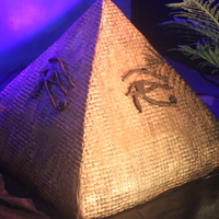 "Night On The Nile Ii  Pyramid created for a belly dance event with King Tut. Pyramid is 14"" L & W and 16"" tall. It is also a solid structure of..."