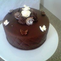 Quilting - Choc Cake Practice cake - wanted to try quilting. Choc cake with white choc ganache with fondant decorations. TFL