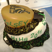 Topsy Turvy Graduation Cake This graduate wanted the topsy turvy cake, her high school and the university she is attending are both represented on her cake.