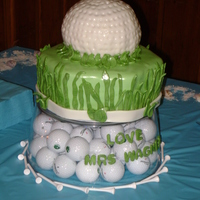Grooms Cake I really had fun with this cake...was a little disappointed in the golf ball, I really struggled covering with fondant, and it was VERY hot...