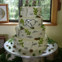 Outdoor Wedding This was a wedding cake for a couple that love the outdoors and woods. The fondant has a birch tree look. The cake board rested on birch...