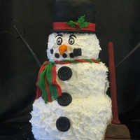 Snowman Cake   This was fun to make. This is Susan Carberry's design from Yummyarts. Buttercream and fondant, 4 tiers.