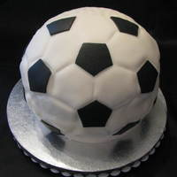 Soccer Ball Cake Birthday cake for my daughter who loves Soccer and my father who loves golf. It's soccer on one side and a golf ball on the other. The...