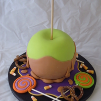 Giant Toffee Apple Cake I finally got to take a course with Andrea Sullivan. All the candy was made with 100% gumpaste. I was sooo thrilled to learn she was in...