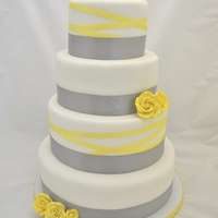 Grey And Yellow Ribbon Wedding Cake  The bride asked for a simple cake with grey (as this was what her bridesmaids were wearing). I also knew that her flowers were all yellow...